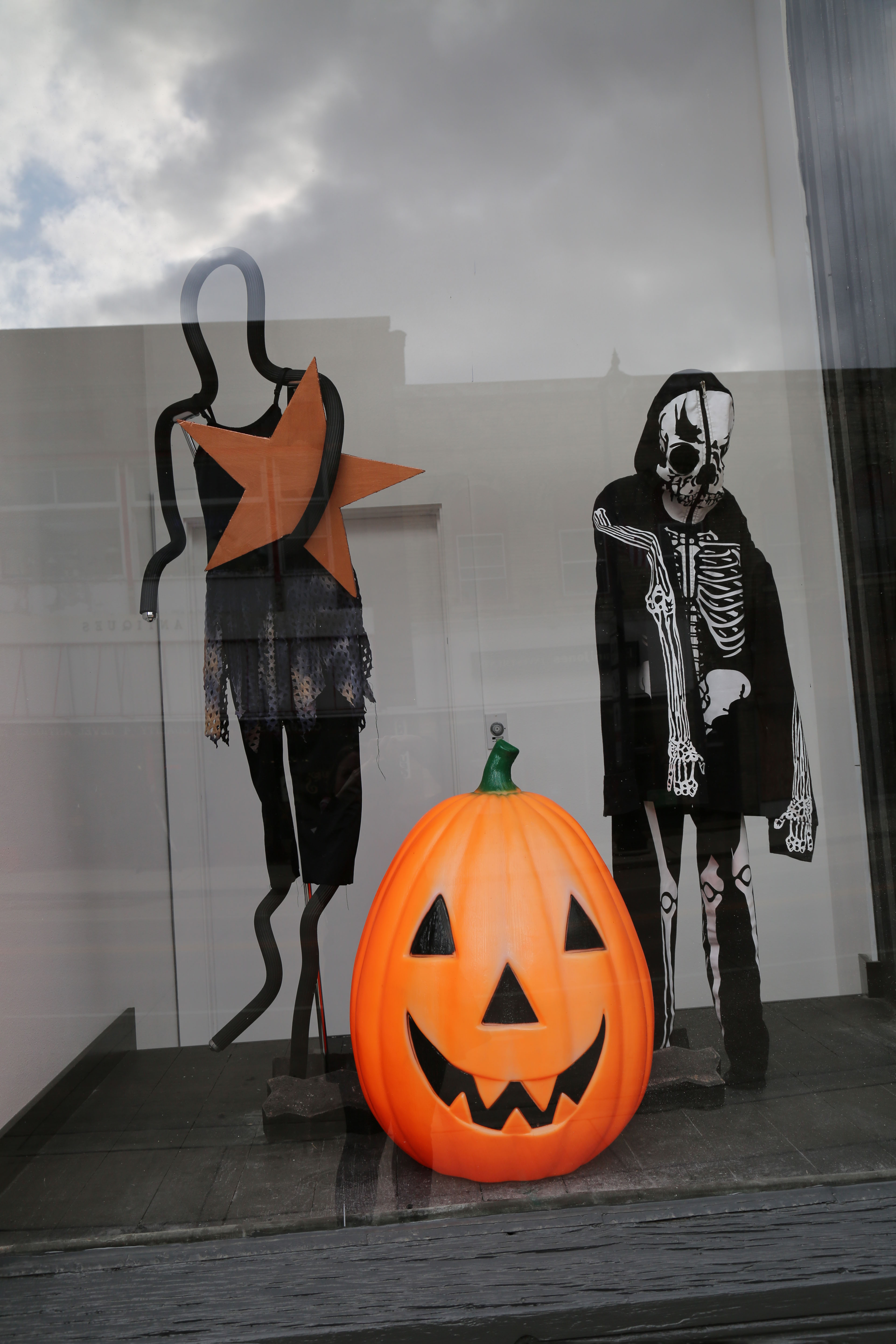 Costumes on mannequins and a large jack 'o lantern